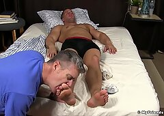 Unaware hunk toe licked and sucked while sleeping in bed