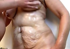 Lesbian grandmother catches hot young girl in the shower